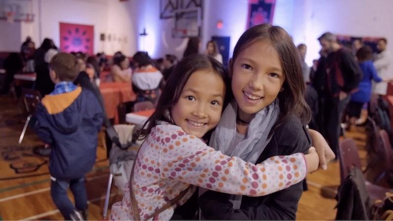 a girl hugs her sister