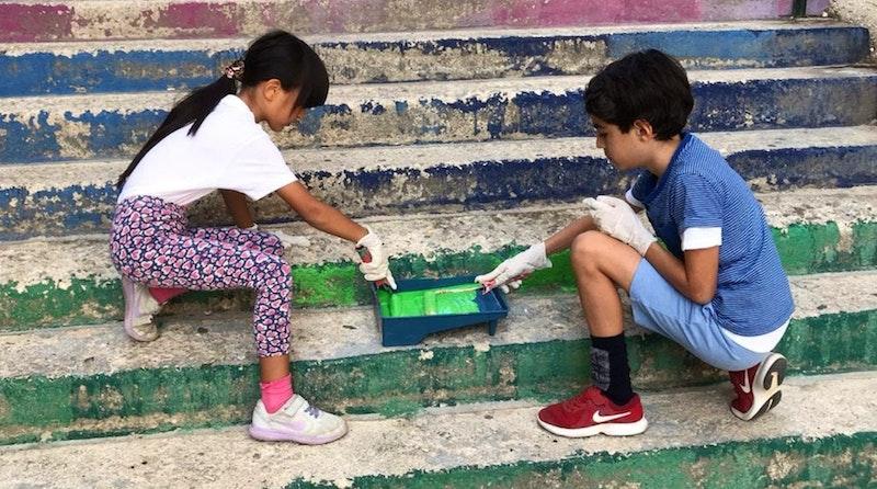 children painting stairway stairs
