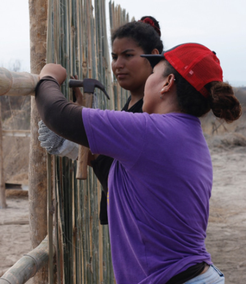 women making a fence