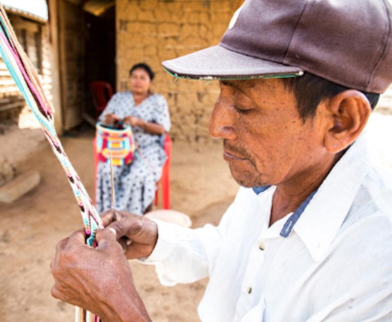 man is weaving a beautiful ornament